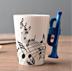 China Creative two tone color glazed ceramic V Shaped Mug with musical instrument handle supplier